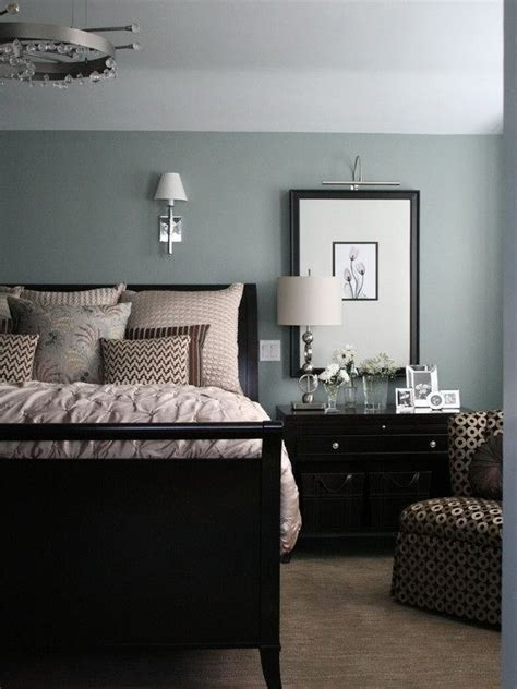 black furniture with walls that are blue with a green tint this is my favorite color ever