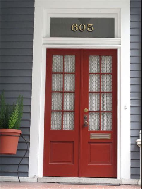 gray house  red doors    yellow living