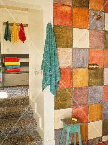 Rustic Bathroom With Multicoloured Tiles On Wall Next To