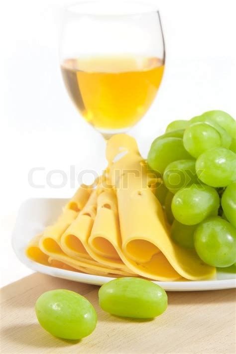 glass  white wine sliced cheese stock photo