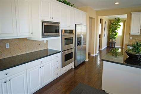 updating kitchen cabinets with paint how to paint kitchen cabinets diy true value projects 8761