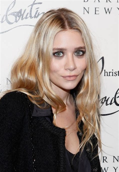 ashley olsen center parting long wavy hairstyle