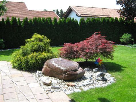Quellstein Japanischer Garten gartenbau reiser quellstein aus porphyr mit
