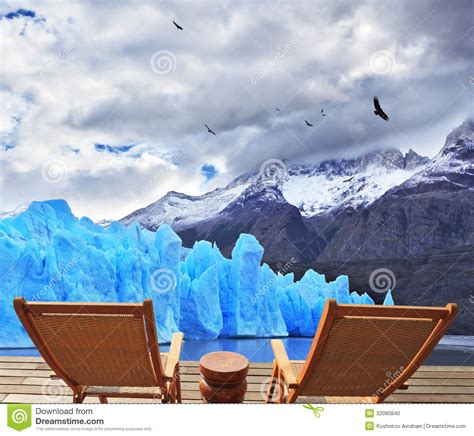 two folding wooden chairs and perito moreno glacier stock