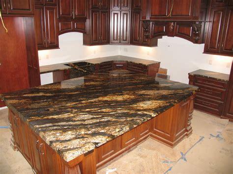 magma gold mitered sink mediterranean kitchen