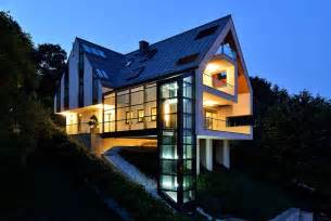 simple slope house plans ideas photo a house on a slope connects to its surroundings through a
