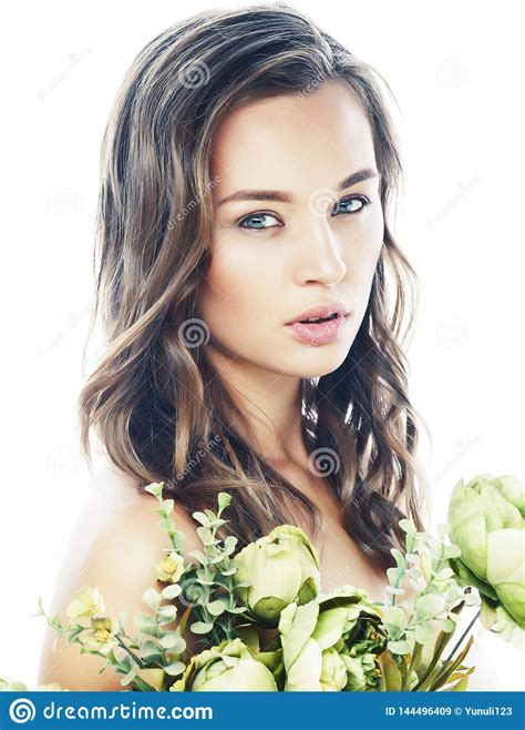 Young Pretty Woman With Fresh Green Flowers Nude Makeup