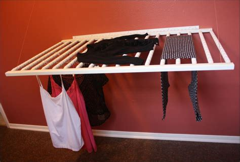 wall mounted laundry drying rack practical laundry rack designs that don t stand out