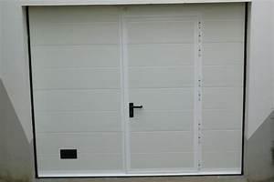 pose de porte de garage sectionnelle a rainures With porte de garage et portes interieures sur mesure