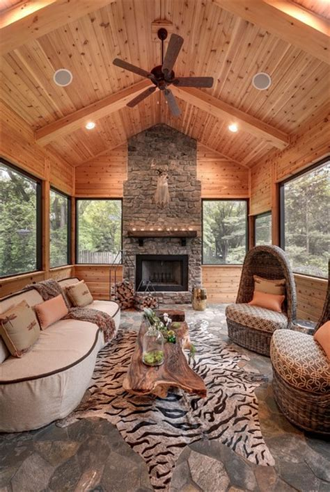 Modern Living Room With Tv by House On The Hill Rustic Sunroom Minneapolis By
