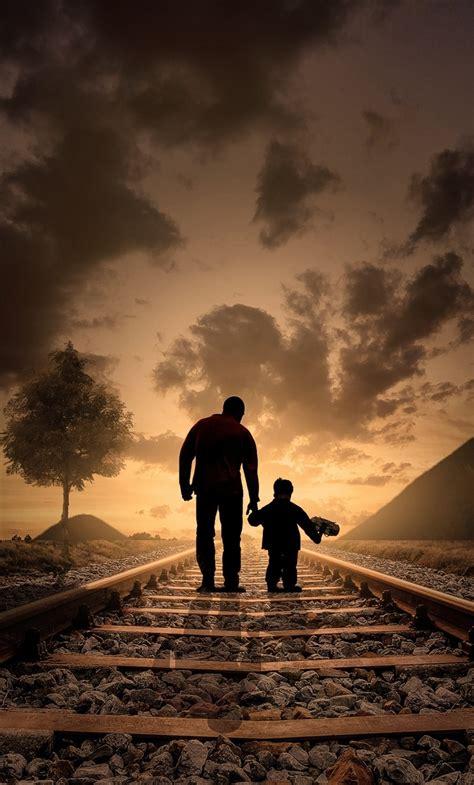 father son walking railraod iphone  hd