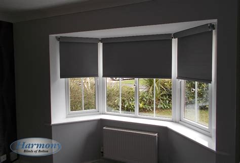 Grey 'senses' Roller Blinds With Chrome Finishes In A Bay