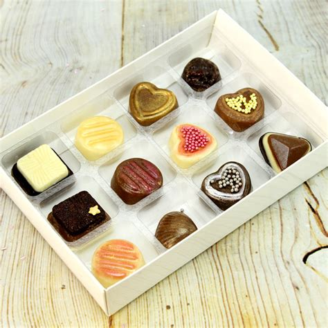 white boxes  clear inserts  lids   chocolates