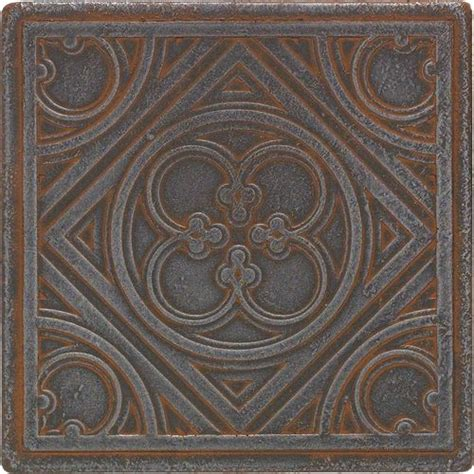 check out this daltile product castle metals wrought iron clover insert cm02 think i just