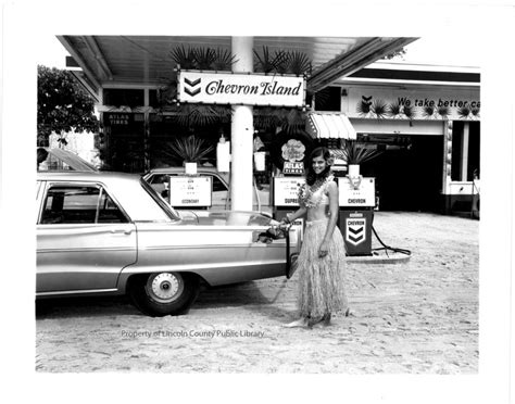 Hula Girl Pumping Gas At Chevron Station.