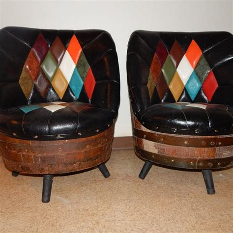 barrel table and chairs pair of whiskey barrel and leather look chairs ebth