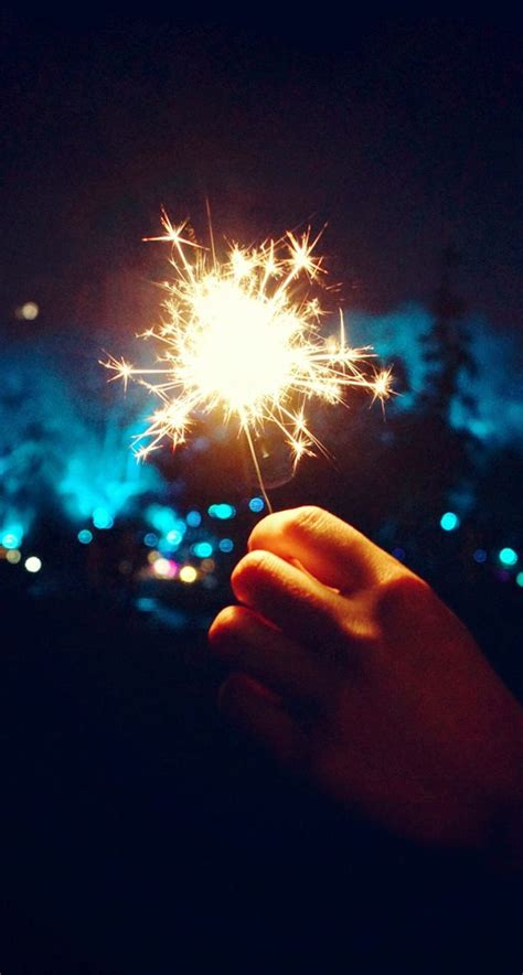 happy  year fireworks hand iphone   hd wallpaper