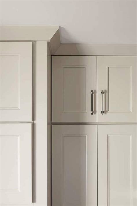 inset shaker style doors with cove crown and light crown moulding cabinetry