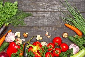 Healthy eating background. food photography different vegetables on dark wood background ...