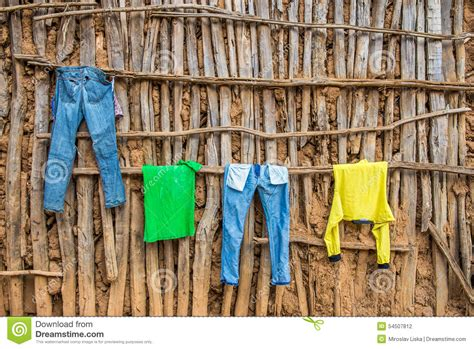 hang clothes on wall clothes hanging on wall of a wooden hut in africa stock photo image 54507812