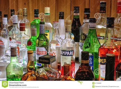 how to a glass shelf collection of alcoholic drinks editorial stock image