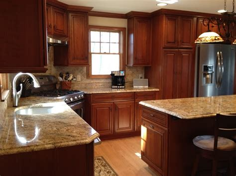 schrock whiskey black  cherry cabinets corner stove
