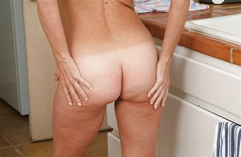 Barefoot Janet Undressed In The Kitchen