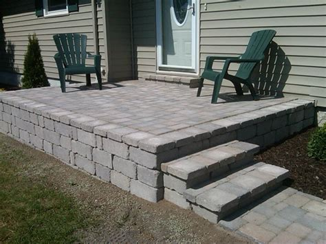 raised patio with custom built stairs age landscaping