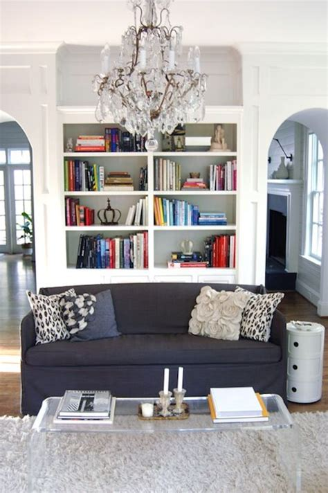 Shop our great selection of blue coffee table books & save. - Chic living room with white built-ins, navy blue slipcover sofa, ...   Bookshelves in living ...