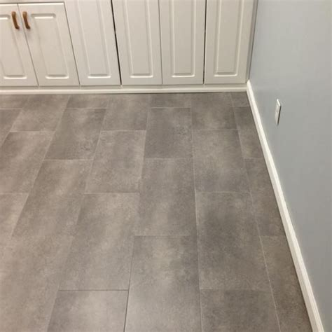 trafficmaster groutable vinyl floor tile trafficmaster ceramica 12 in x 24 in coastal grey vinyl