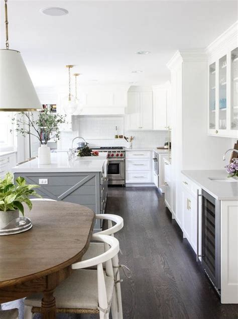 kitchens with hardwood floors and white cabinets gray island with katie acorn pendants transitional kitchen 770 | white kitchen cabinets with dark stained oak wood floors
