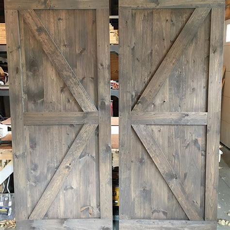 Interior Door Stain Colors by A Pair Of Brace Barn Doors With A Mix Of Classic