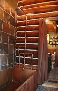 exposed plumbing fixtures rustic bathrooms