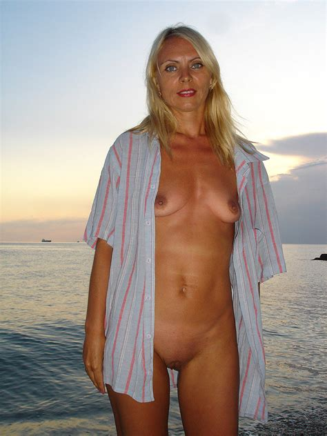 Sexy Blonde Milf Posing Naked On A Nude Beach Photos