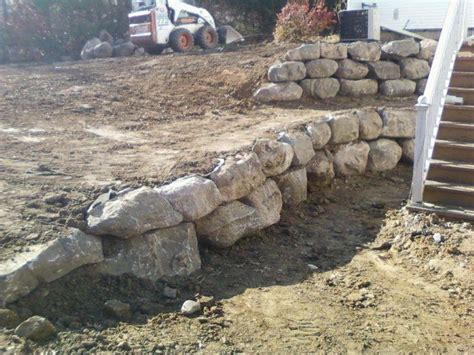 retaining wall with boulders boulder retaining wall garden pinterest