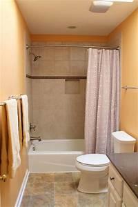 Vinyl Floor Kohler Toilet In White Tile Tube Surround