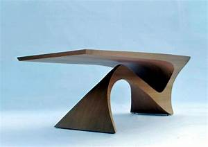 Futuristic wooden table design of the series Form Follows