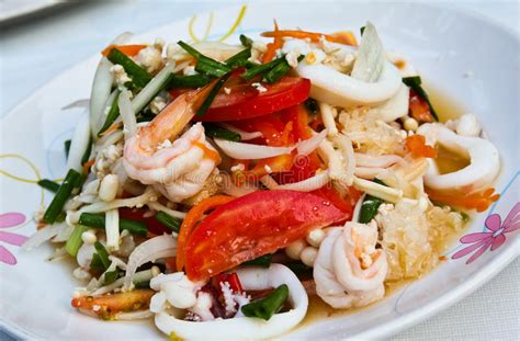 Place ginger, onion and chilies over shrimp. Thai spicy seafood salad. stock image. Image of pepper - 18766987