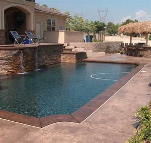 Dark coping mid tone mottled stones backyard pools for Pool deck ideas made from concrete