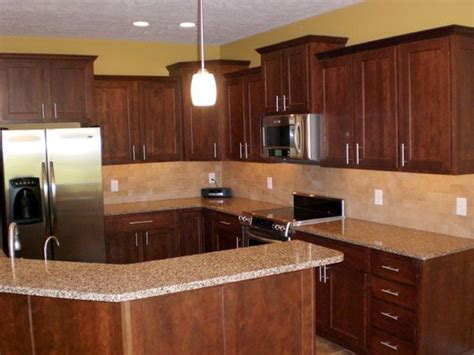 kitchen ideas with cherry cabinets note cherry wood cabinets light granite and gold wall
