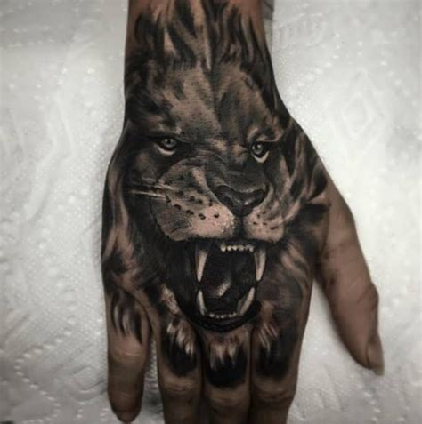 tattoo roaring lion  hand httptattootodesigncom