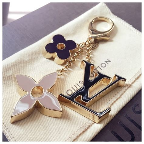 louis vuitton louis vuitton fleur de monogram bag charm  dore  sunnys closet  poshmark