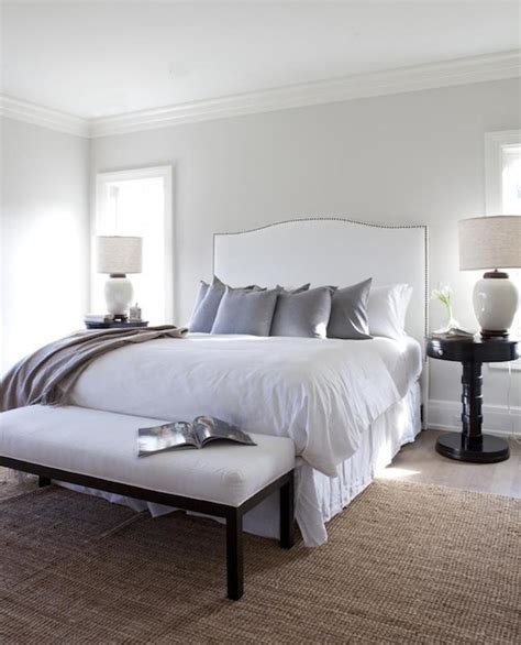 bedroom with grey upholstered headboard white upholstered headboard transitional bedroom
