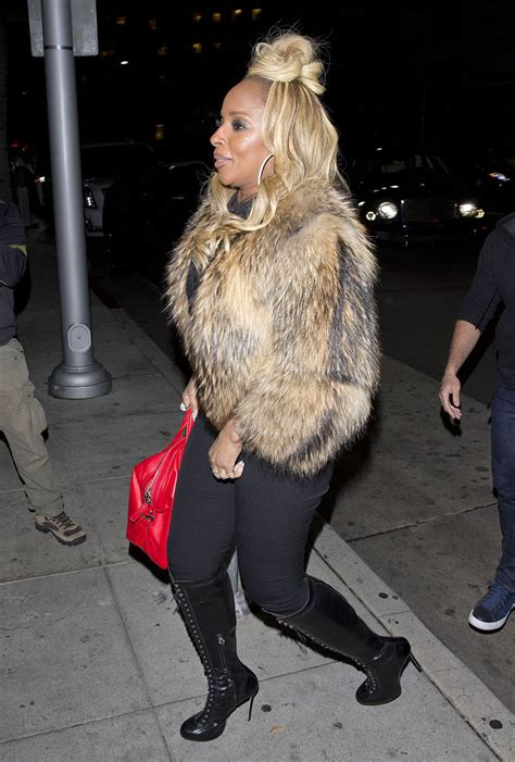 mary  blige   wearing  fur coast knee high boots