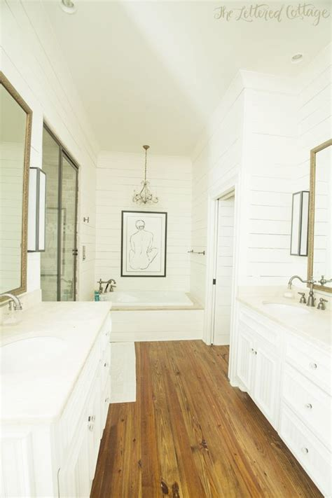 Bathroom Hardwood Floor by Traditional Bathroom White And Wood Wood Floors For