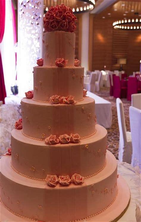 tier  pink wedding cake  carnation rosesjpg