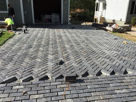 Unilock Paver Installation by Installation Of Unilock Driveway Elvio And Sons