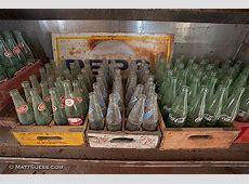 Old empty glass soda bottles Dr Pepper Sunkist Coca Cola Coke