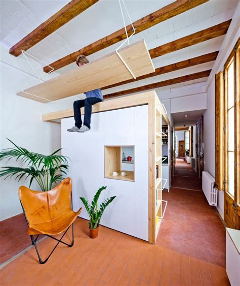 Hanging From Ceiling by Wooden Desk Is Hanging From The Ceiling In This Apartment