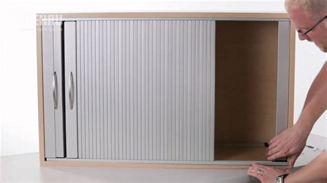 installing a horizontal tambour door with top track